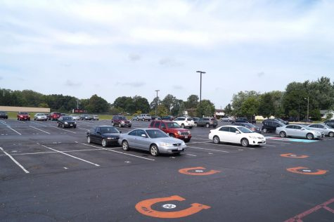 The parking lot doesn't have a lot of cars in it.