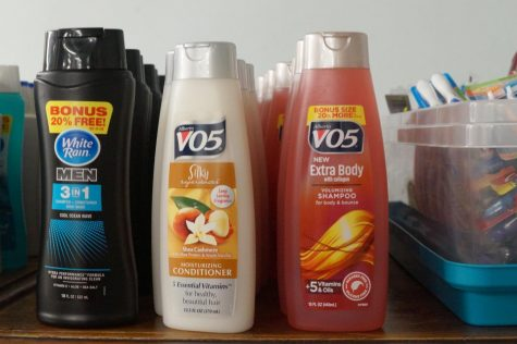 "Rows of shampoo bottles labeled ""VO5""."