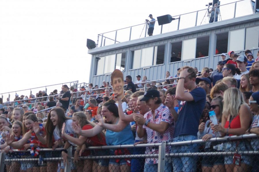 Seniors student section cheering on the football team.