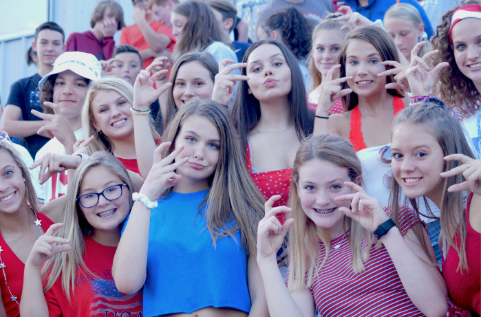 Freshman student section dressed up for the USA themed football game.