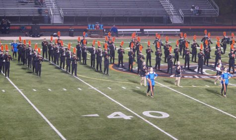 The band performs at the last football game of the season. The band finished their season with a variety of awards.