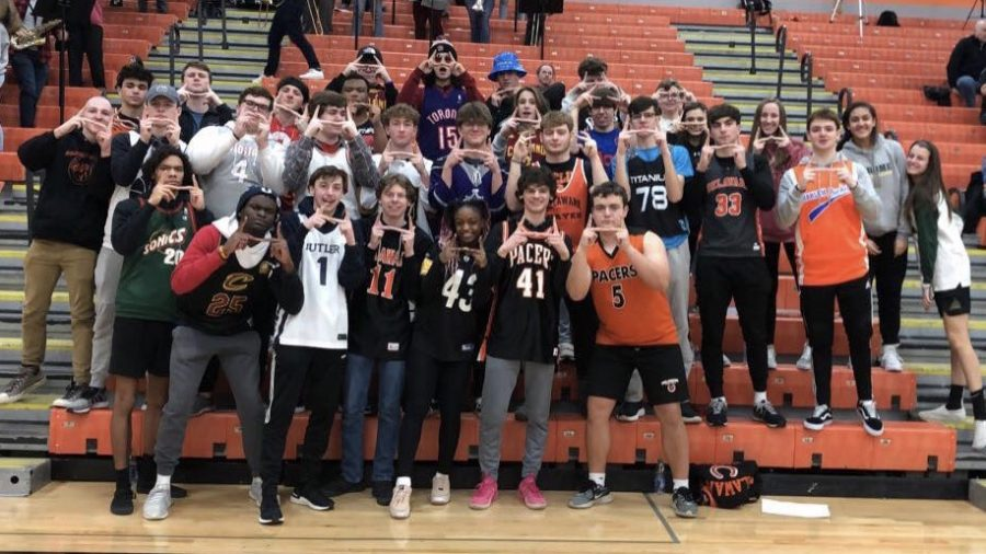 Heffner Hecklers posing for a photo after the girls basketball final home game. Heffner Hecklers look to support sports that don't get Recognition from Euclid Entourage.