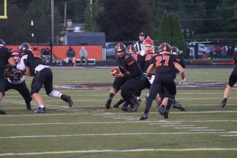 Junior Austin Dowell carrying the football