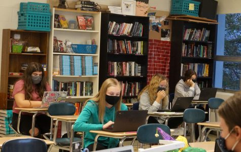 Students working in class, wearing masks