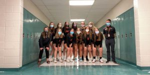 Varsity volleyball team with masks