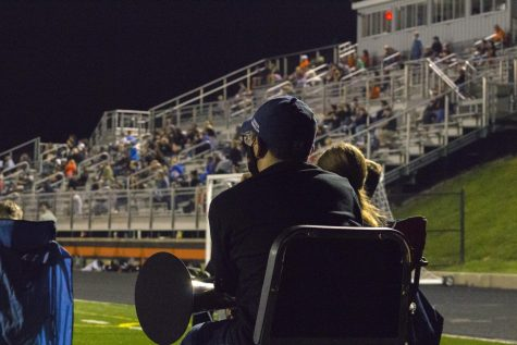 Marching Band member watching the game ready to play.