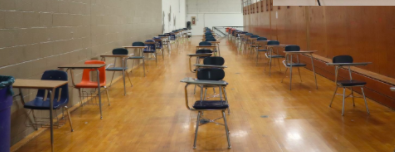 chairs in lines in empty gymnasium