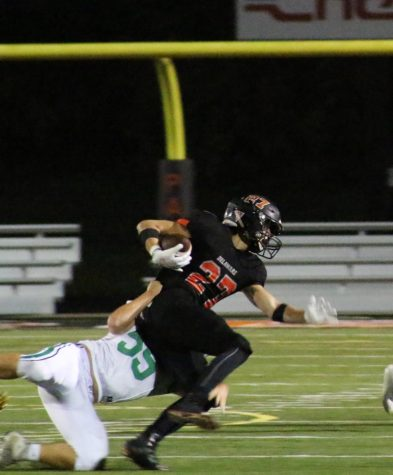 Dublin Scioto player attempting to tackle number 27.