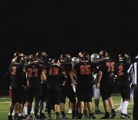Hayes varsity football team standing on the field.