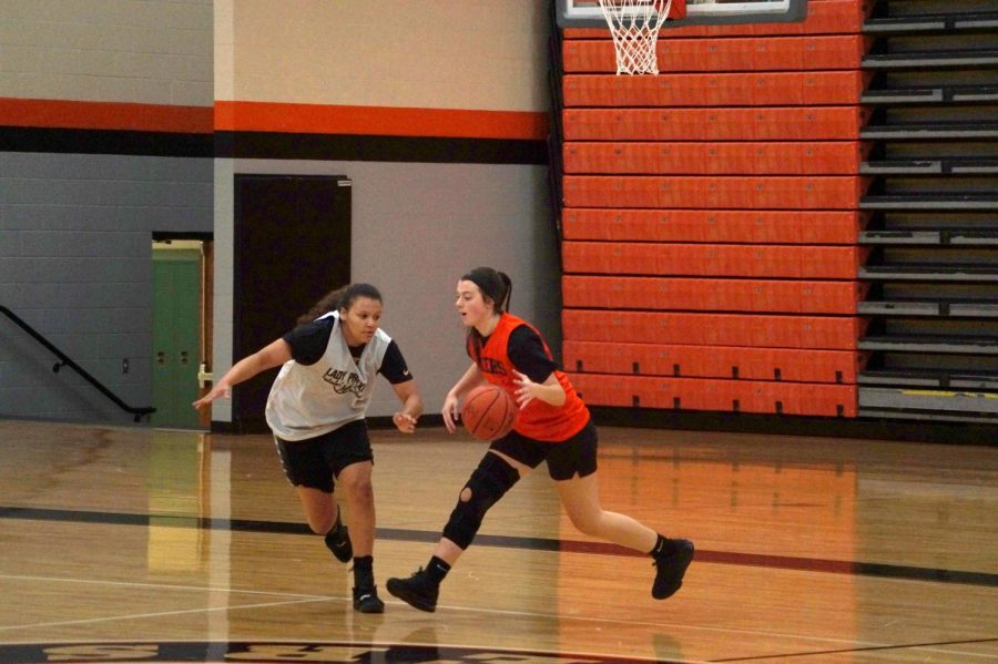 Junior Sophia Nice moves the ball down the court