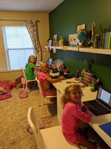 Members of the Luce family show off their online learning environment.  Having to balance supervising the education of kids with a full time job has made life much more challenging for many working-from-home mothers.
