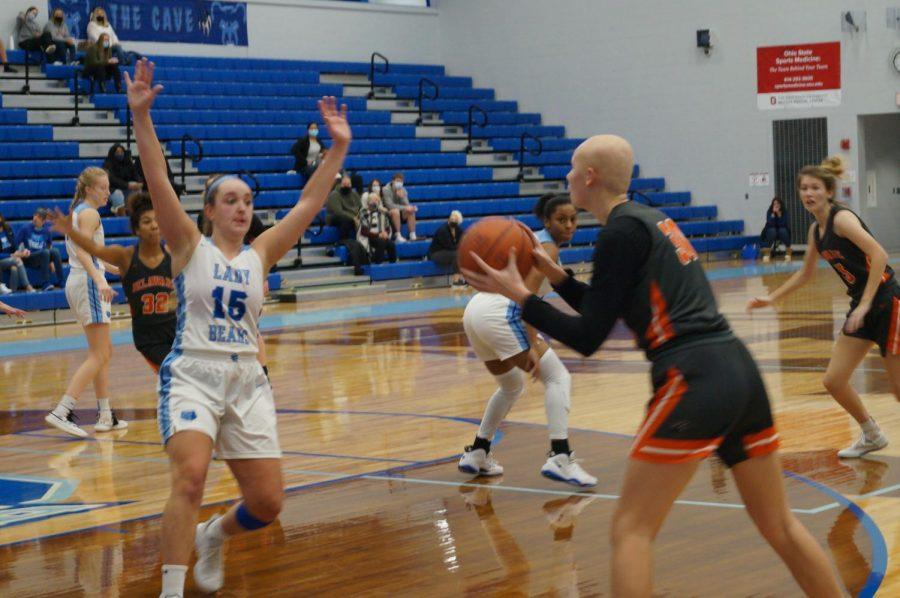 Hayes basketball player shoots the basketball.