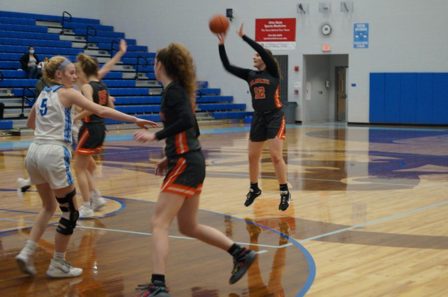 Hayes basketball player shoots a three point shot.