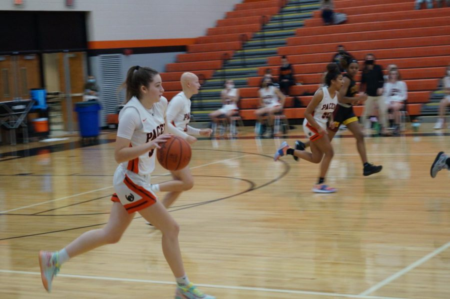 Lady Pacer hustles down the court.