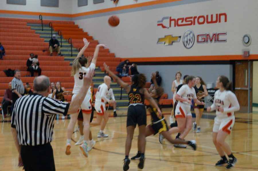 Lady Pacer shoots a three point shot.