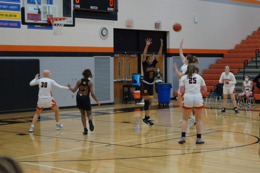 Lady Pacer makes a jump shot.