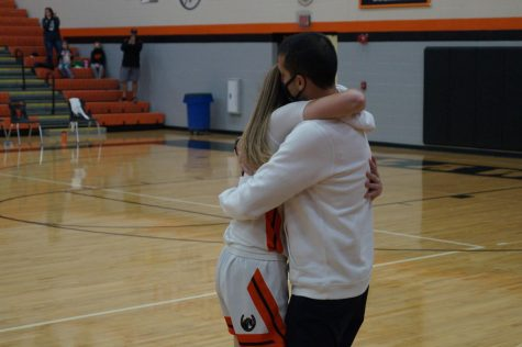 Lady Pacer hugs her dad after scoring 1000th point.