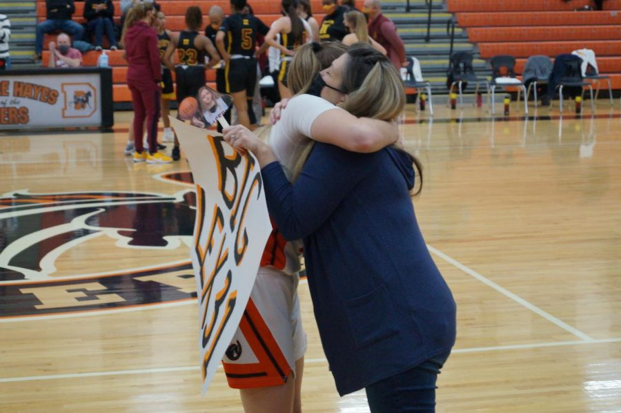 Lady Pacer hugs mom.