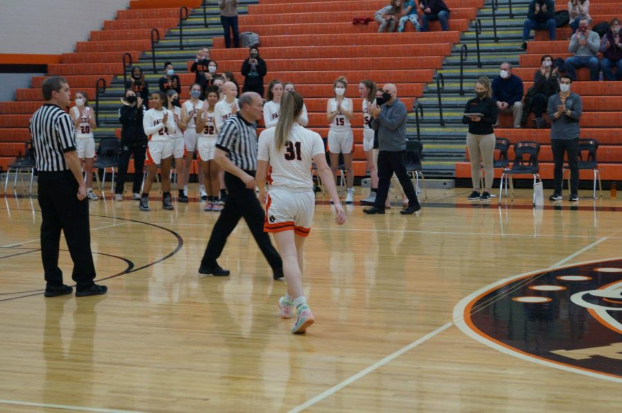 Lady Pacer celebrates with team.