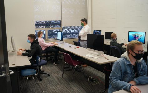 Members of Hayes Cinematics work on individual projects in the video production computer lab.  Covid-19 restrictions have prevented students from collaborating in groups like they have in previous years.