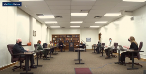 Mackenzie Collett (far right) discusses a student report on the online learning method done district-wide in the winter. The board met on January 4 to discuss plans for returning back to school.