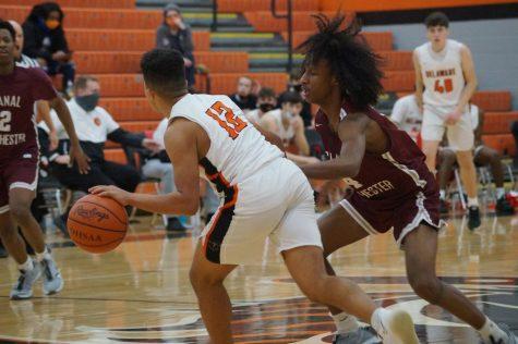 Hayes basketball player dribbles ball.