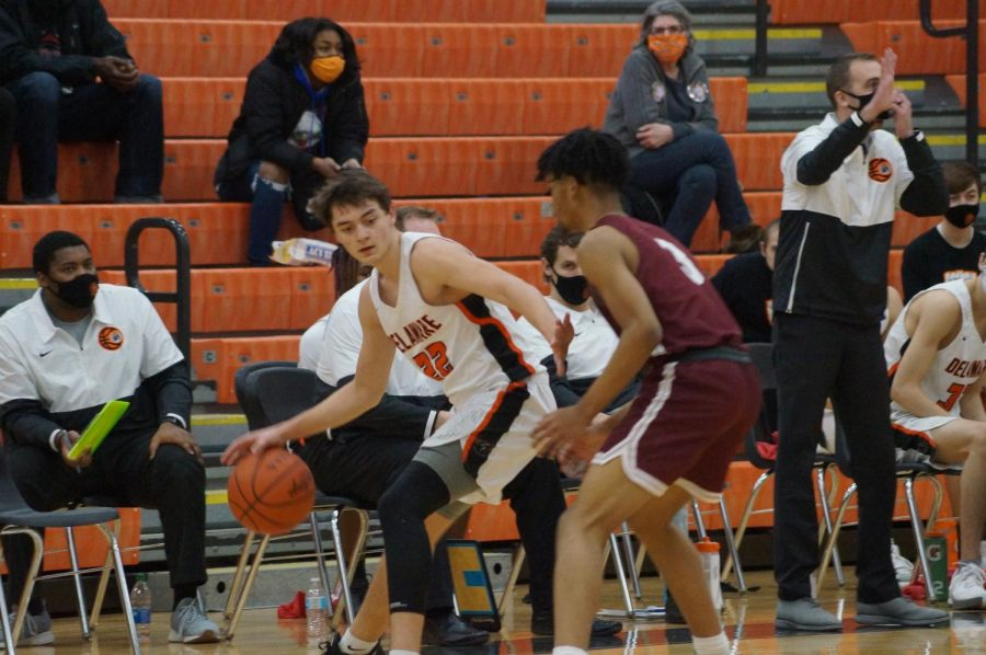 Hayes basketball player looks for another Pacer to pass the ball to.