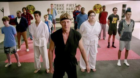 Johnny Lawrence (played by William Zabka) leads a karate class in his dojo, Cobra Kai.