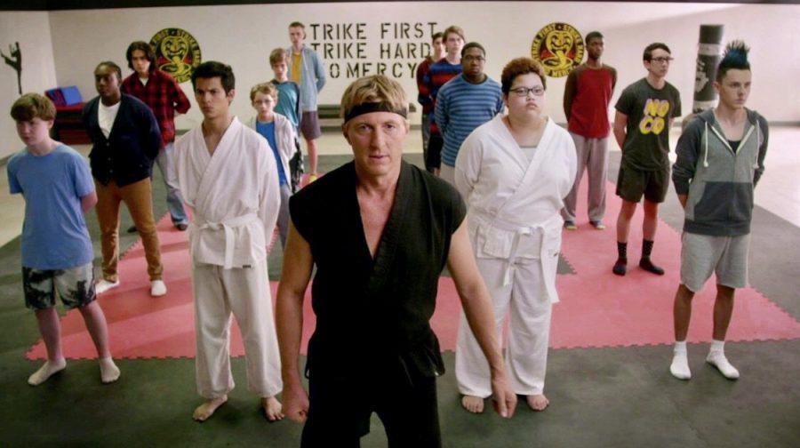 Johnny Lawrence (played by William Zabka) leads a karate class in his dojo, Cobra Kai.
