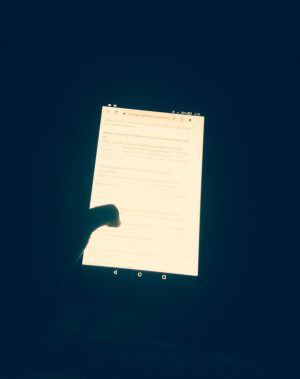 Picture of bright phone screen in dark room