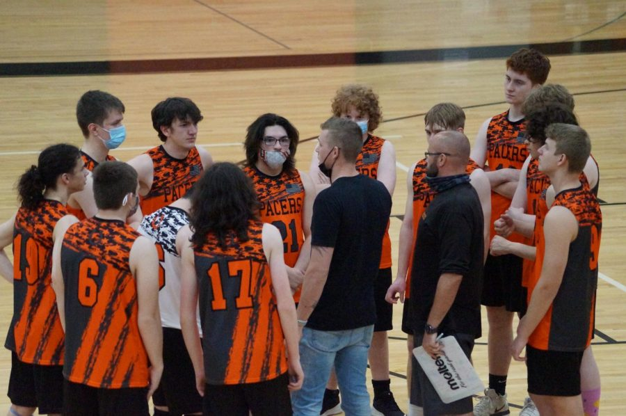 Coach Jake Hackathorne provides coaching to the boys during a time out.