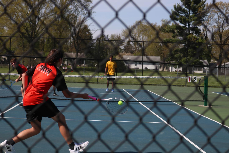 Grant LaMar hits the ball.
