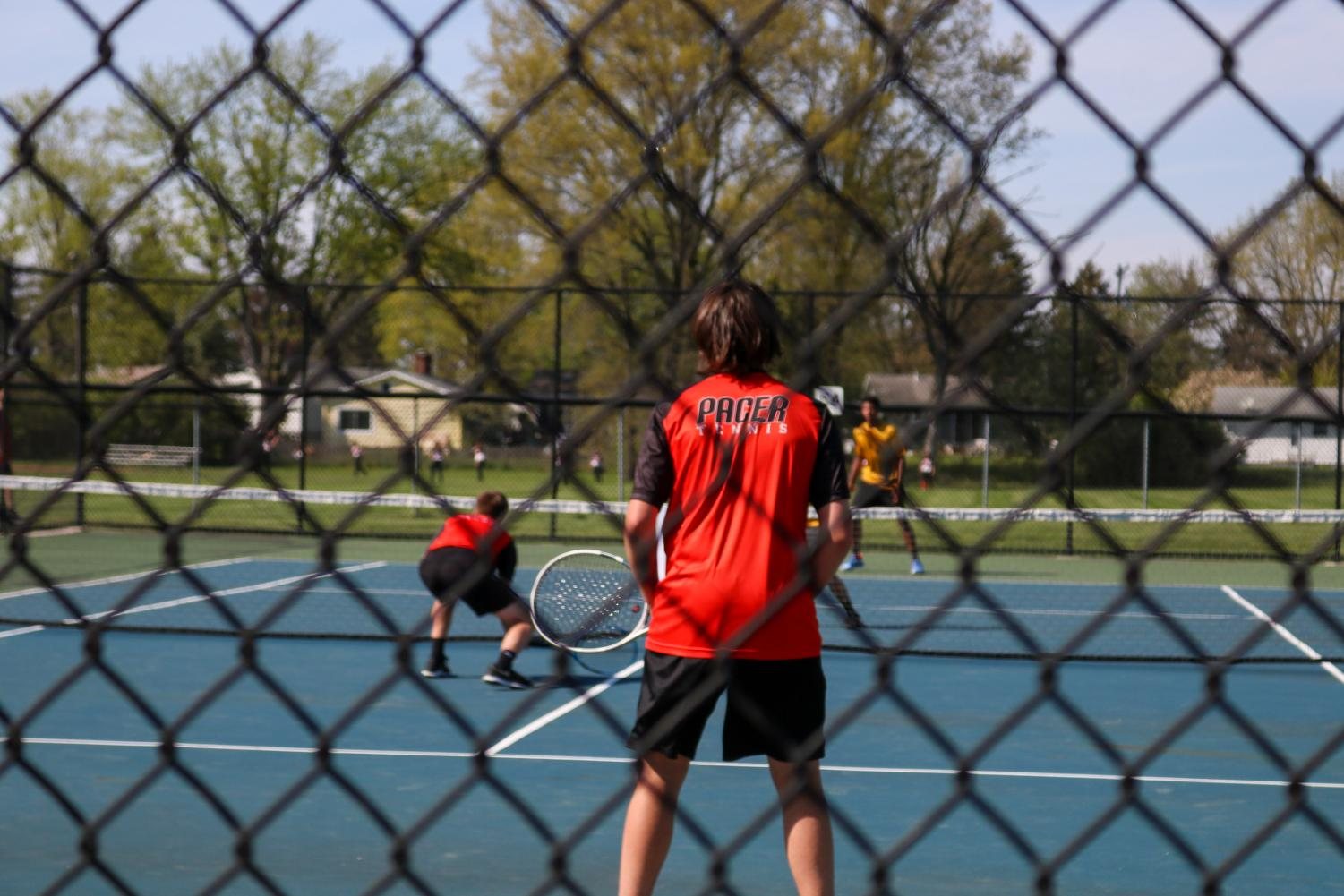 Grant LaMar and Ryne Higgins wait for their opponents to serve.
