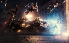The Justice League leap into battle in