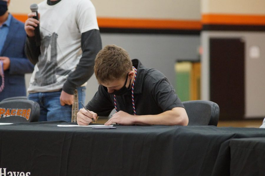 Nicholas Brooks signs for the Marine Corps.