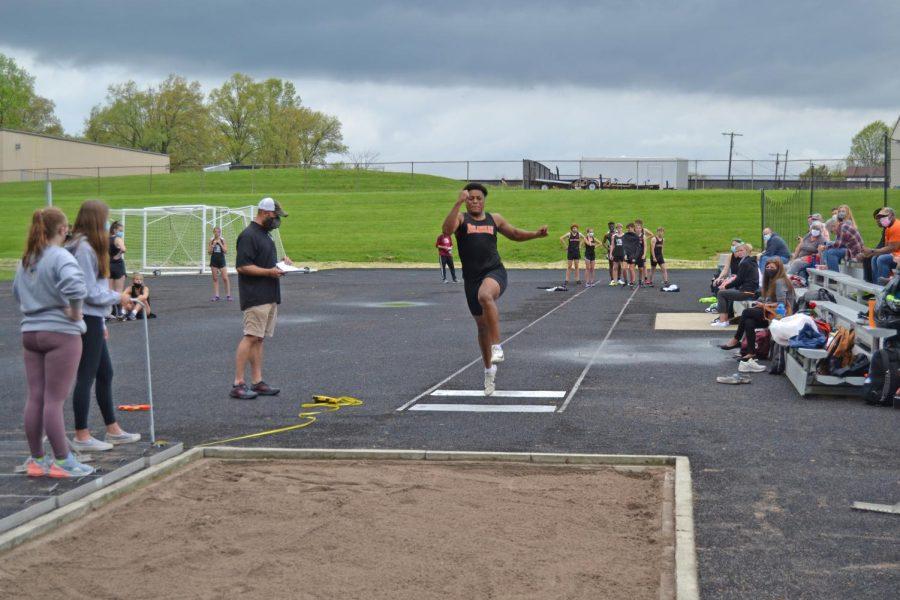 Senior Alex Blevins jumps off the board.