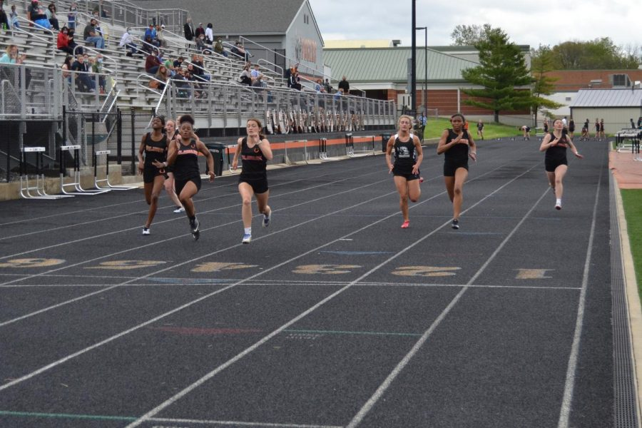 Runners in 100 meter dash near the finish line.