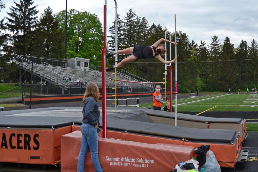 Senior Rebecca Young clears the bar.