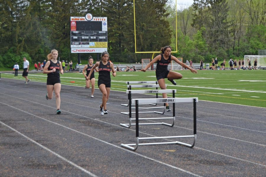 Sophomore Olivia Dean clears hurdle while in the lead for the 300 meter hurdles.
