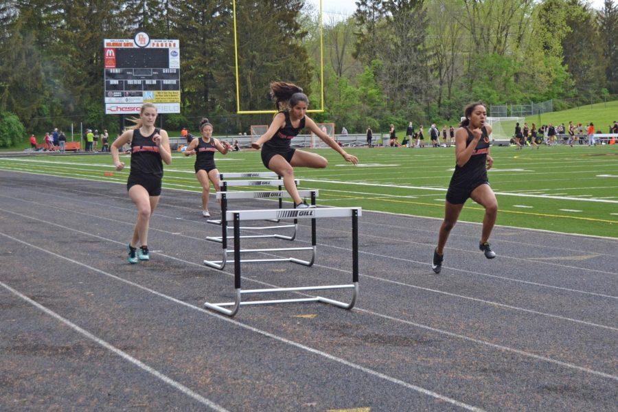 Freshman Abrianna Hite clears the hurdle.