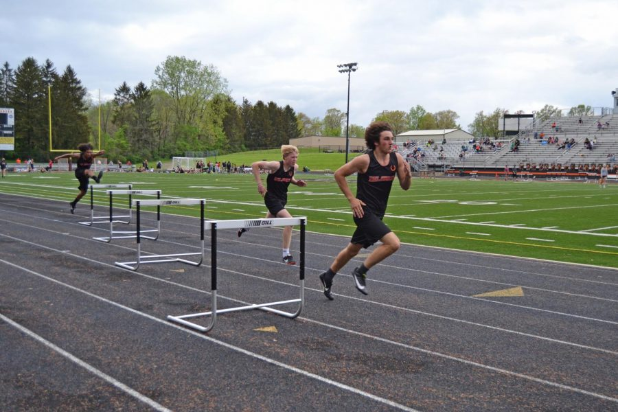 Tyler Zembo leads in the 300 meter hurdles, Will Polter and Caleb Forney follow close.
