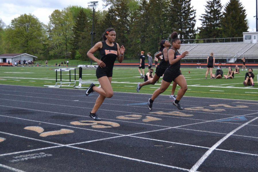 Runners finish 200 meter dash.