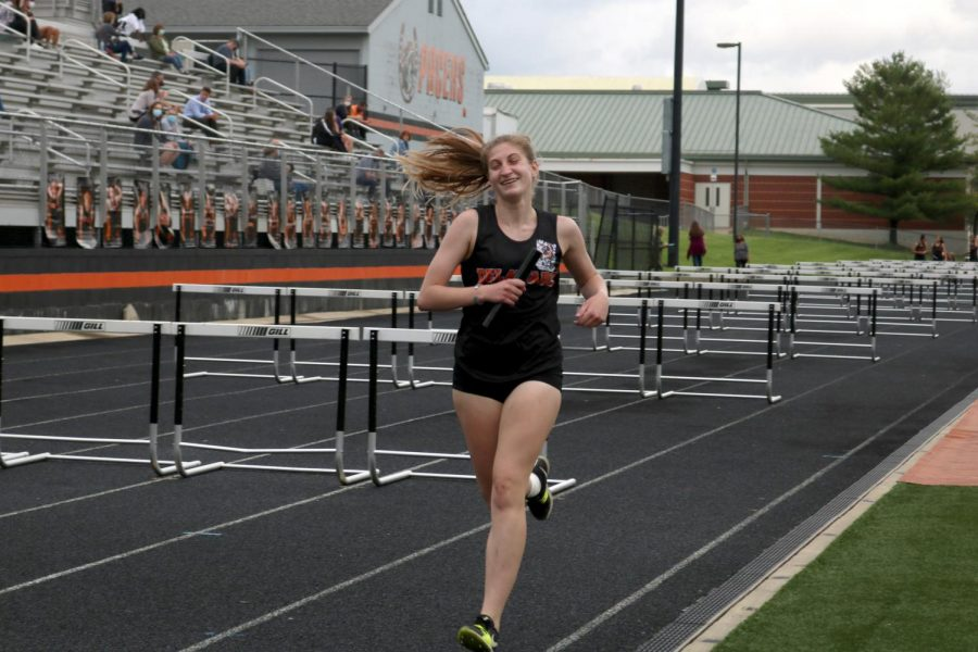 Junior Miranda Gemberling on the last stretch of the 4x800 relay.