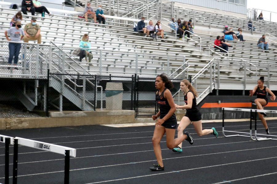 Three athletes running