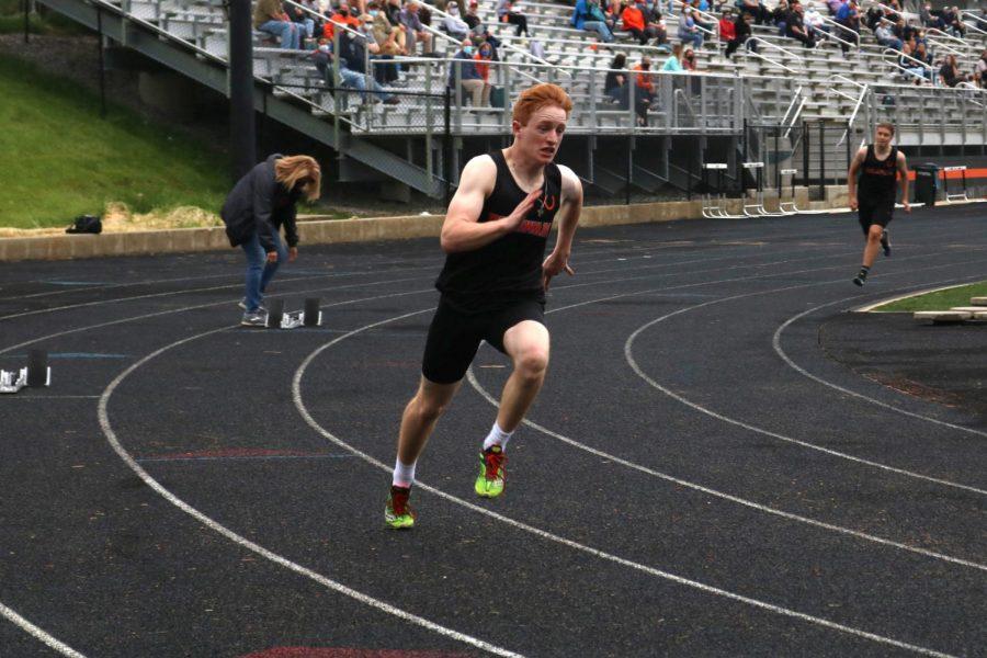 Senior Josh Koeler turns the first corner in the 400 meter dash.