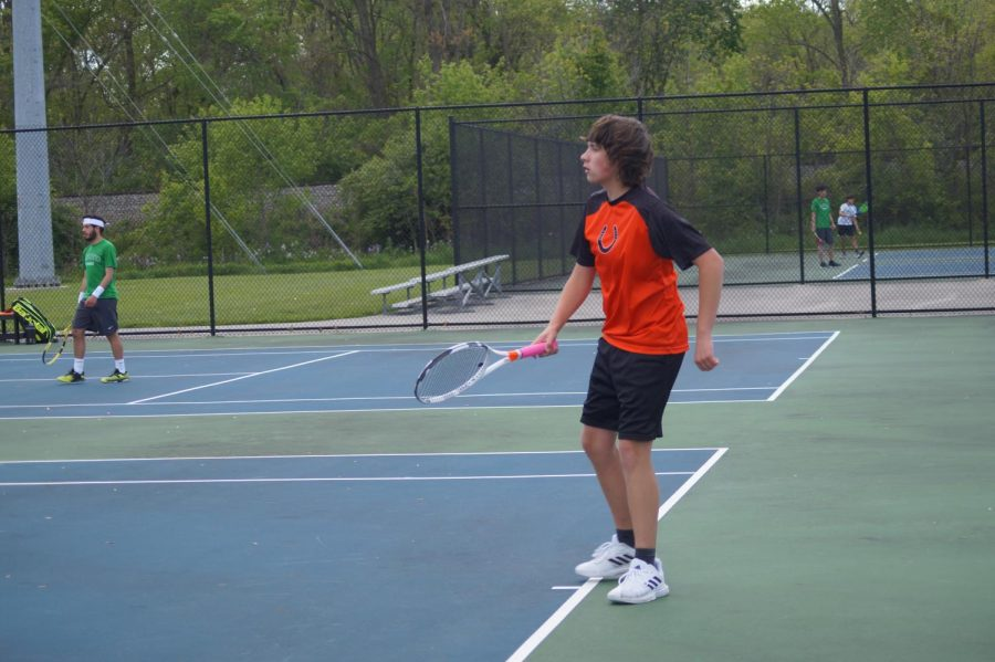 Freshman Grant Lamar waits for his opponent to serve the ball.