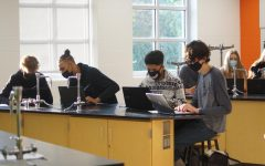 Students work during Keith Buttss physical science class.  Students are required to wear masks at all times inside the building, except while at lunch.