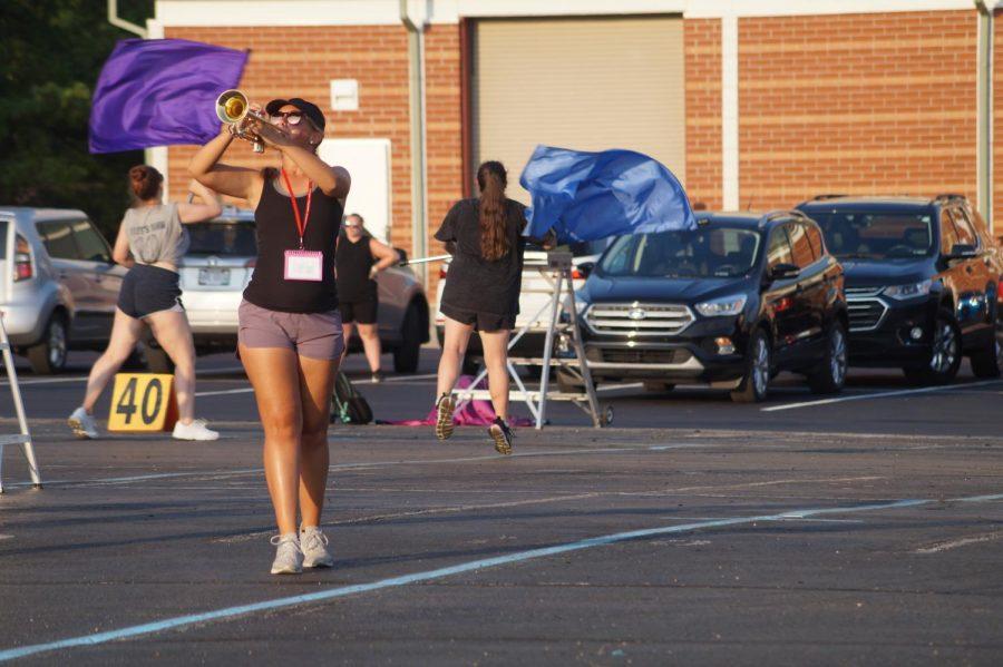 Senior Maddie Bricker playing trumpet.