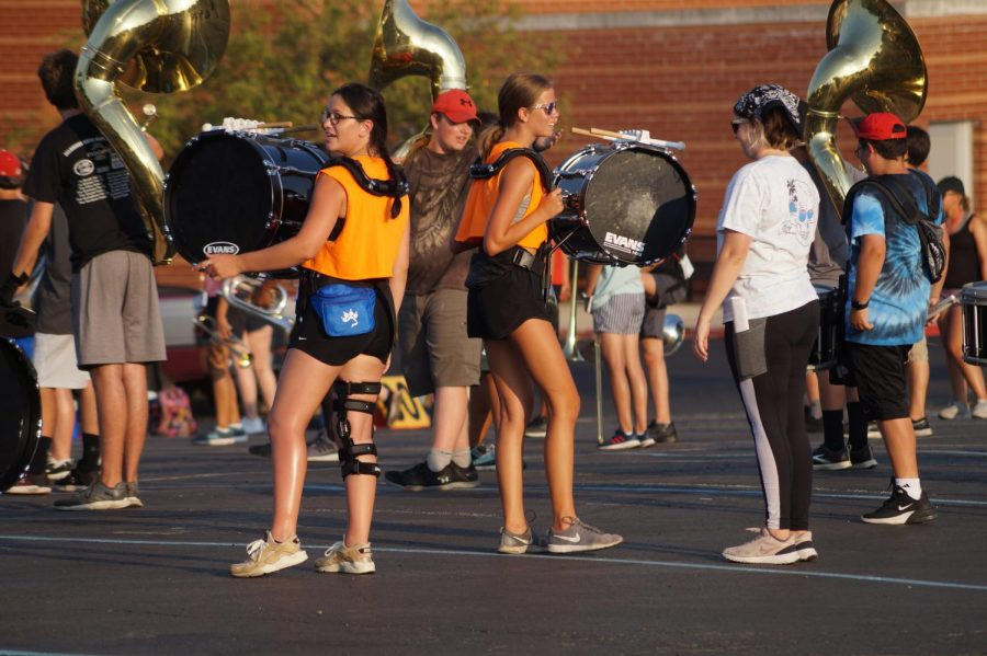 Reagan Connar and Lindsay Cooke bass drum players in between sets.