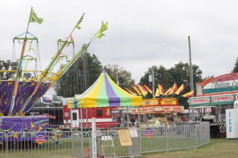Rides and food trucks located at the Fair Grounds.